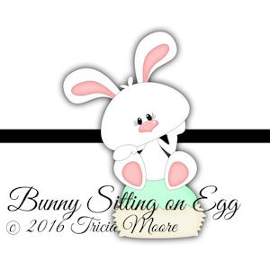 Bunny Sitting on Egg